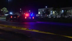 In this image taken from video, police respond to the