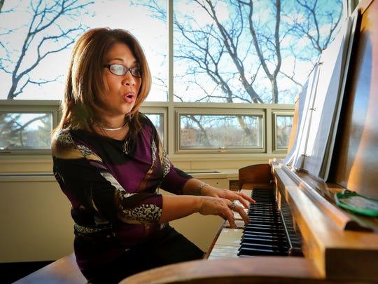 Music director,  Maria Leonor Llorin, rehearses with