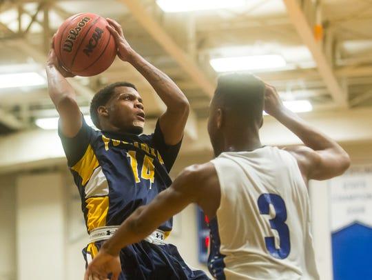 Pocomoke guard Tyrone Matthews (14) goes up for a shot