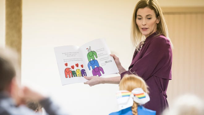 Author Christine Callahan reads her children's book to a group of Daisy and Junior Girl Scouts during a meeting at St. Paul's United Church of Christ Tuesday.
