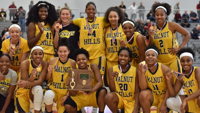 The Walnut Hills Eagles celebrate their District Championship Saturday, March 3rd at Princeton High School
