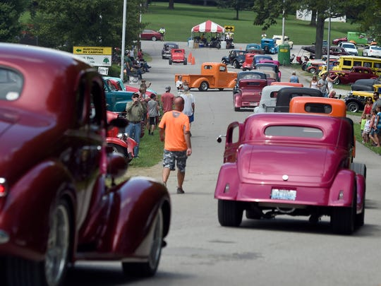 Hot rod owners head for the exit after attending the