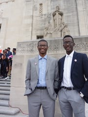 Isiah Chavis (left) and Reginold Boudreaux, seniors in the Legal Academy at Northside High School in Lafayette, on the steps of the Capitol Wednesday.