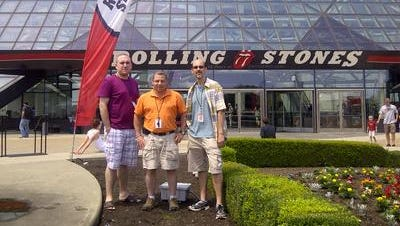 From left, teachers David Grazioli, Rick Kauffman and Martin Billig stand outside the Rock and Roll Hall of Fame in Cleveland last year. They attended the Hall's Summer Teacher Institute.