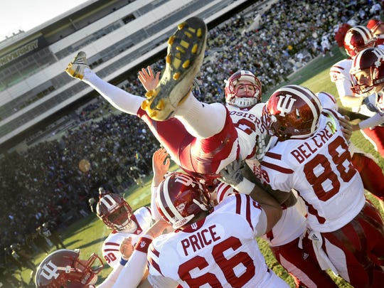 IU kicker Mitch Ewald is lifted into the air by his teammates after he kicked the winning field goal in overtime to beat the Boilermakers  34-31during the Old Oaken Bucket game at Purdue on Nov. 27, 2010.