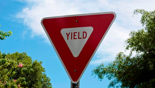 """Drivers looking to renew their licenses in North Carolina will find questions on the test that ask them to identify blank signs by their shape. The idea is that you should know, for instance, that a triangular sign like this one says, """"Yield,"""" even if your view is obscured or the lettering has faded."""