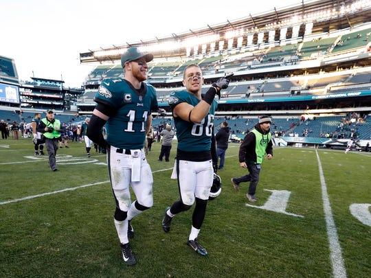 Philadelphia Eagles' Carson Wentz, left, and Zach Ertz walk off the field after an NFL football game against the Chicago Bears, Sunday, Nov. 26, 2017, in Philadelphia. (AP Photo/Chris Szagola)