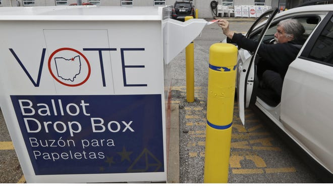 Jim O'Bryan drops of his primary election ballot in the drop box at the Cuyahoga County Board of Elections in Cleveland.