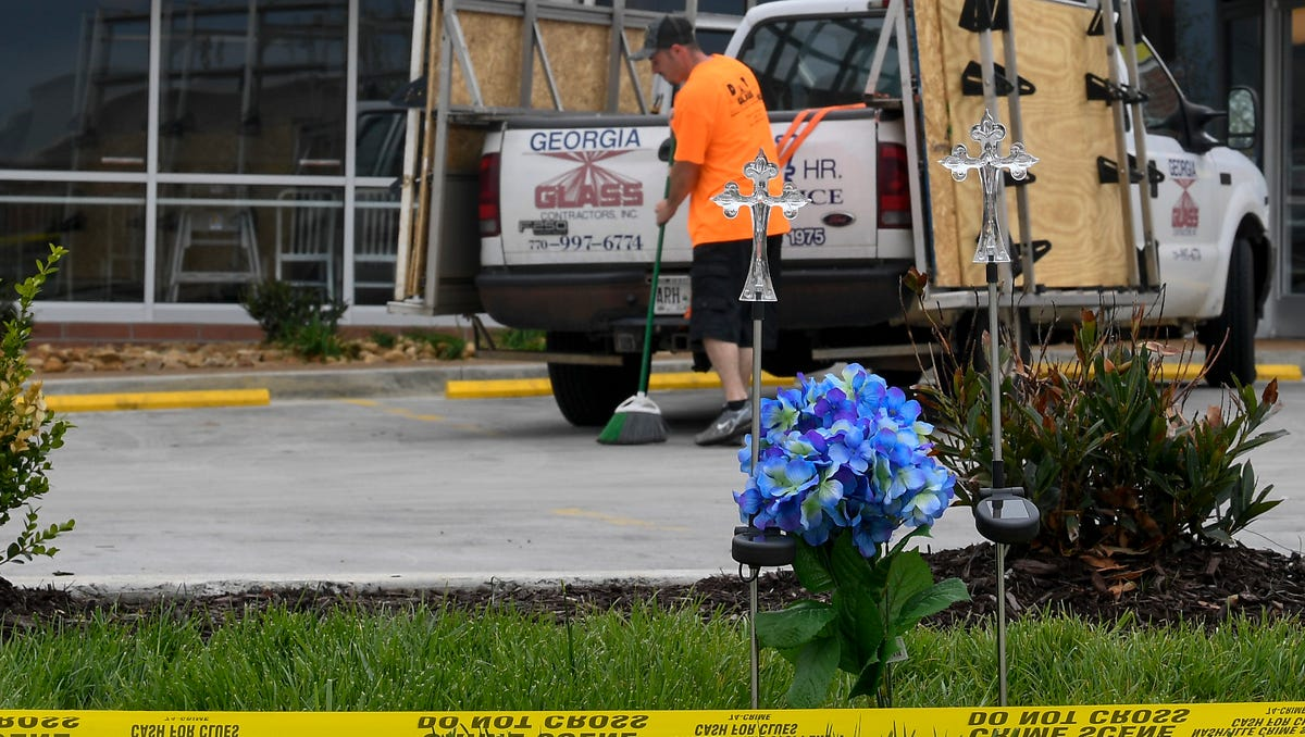 David Jay sweeps broken glass as he and others prepare to re-open the Waffle House where four people were killed Sunday morning in Antioch, Tenn., Tuesday, April 24, 2018.