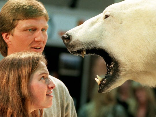 Steve Rahn and Catherine Clinckemaillie of Fort St. John, British Columbia, get a close look at a mounted polar bear at the Safari Club International's Hunters Convention at the Reno-Sparks Convention Center in 2000.