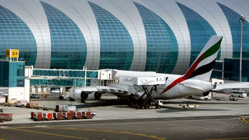 An Emirates airline Airbus A380 is serviced at Dubai International Airport on Feb. 10, 2013.