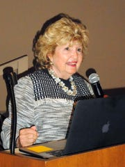 Commissioner Donna Fiala at the podium making opening remarks during the Marco Island Town Hall Meeting;