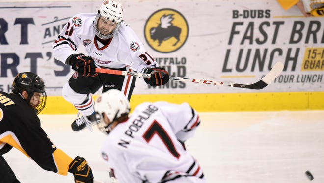 Jake Wahlin fires a pass to a team mate during a game Saturday, Nov. 18, at the Herb Brooks National Hockey Center in St. Cloud.