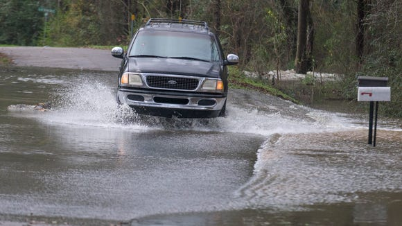 Flash flooding in west Montgomery, Ala. on Christmas day, Friday December 25, 2015.
