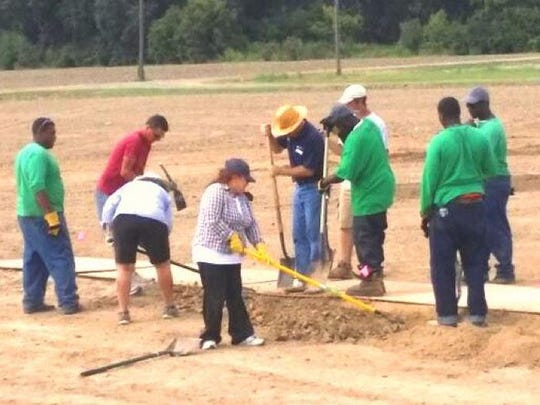 Volunteers spent hours working on the baseball field and facilities.