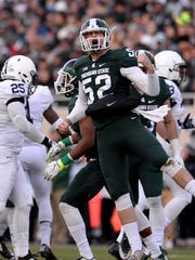 MSU long snapper Taybor Pepper celebrates a tackle on a punt against Penn State on Nov. 28. Pepper, who played his first season at less than 200 pounds, is  235 these days and hoping to play in the NFL.