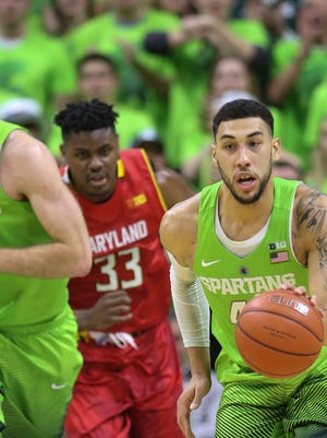 Denzel Valentine, right, runs the fast break with Matt Costello ahead of Maryland's Diamond Stone. MSU's seniors led the victory over the Terps.