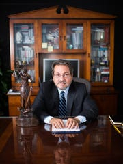 Stephen Montoya sits for a portrait in his office in