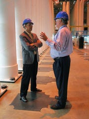 National Association of Manufacturers President Jay Timmons, left, talks with American Centrifuge Plant General Manager Dan Rogers at the Centrifuge plant during a tour in this file photo.