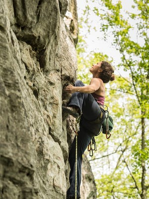 "Laura Boggess climbs in Hidden Valley, Virginia. An expert rock climber and professor at Mars Hill University, she will speak  on an all-women panel at the ""No Man's Land"" Film Festival in Asheville."