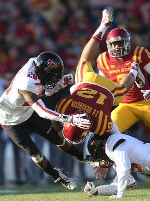 Iowa State quarterback Sam Richardson (12) is upended Saturday against Texas Tech. He completed 24-of-38 passes for 304 yards and two touchdowns.