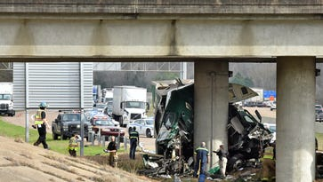 Emergency officials respond to the scene of a fatal motor vehicle wreck after an 18-wheeler crashed into a pylon on the Fortification Street bridge on the southbound lane of I-55 Tuesday.