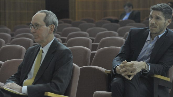 Attorney Robert Emmanuel, left, and Studer Properties president Andrew Rothfeder, right, await city council's vote on a tax break for Daily Convo, LLC.