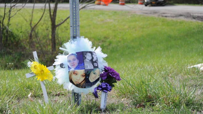 A memorial, at the corner of Ohio 32 and Union Hill Road, to the eight victims who died in four homes in Pike County Friday.