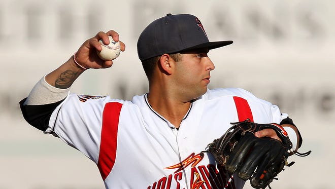 Volcanoes shortstop C.J. Hinojosa throws to first for a force out against Boise at Volcanoes Stadium, on Wednesday, July 15, 2015, in Keizer, Ore.