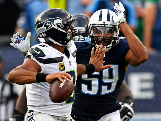 Seahawks quarterback Russell Wilson (3) faces pressure