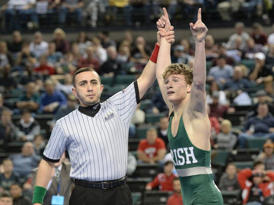 Camden Catholic's Lucas Revano reacts after defeating Howell's Kyle Slendorn in the 132-pound state final match last March. The senior is back to defend his state title, bumping up to the 145-pound weight cal