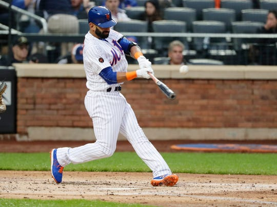 New York Mets' Jose Bautista (11) hits a double during the second inning of a baseball game against the Miami Marlins Tuesday, May 22, 2018, in New York.