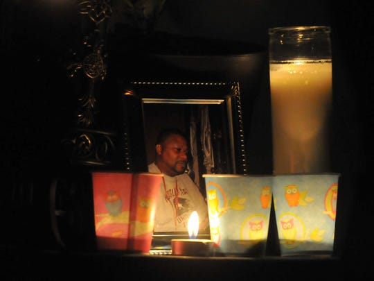 Candles surround a photograph of Brian Chisholm during
