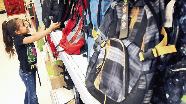 Yasmine Hernandez looks at the selection of backpacks at Target during a recent tax-free weekend in Las Cruces.