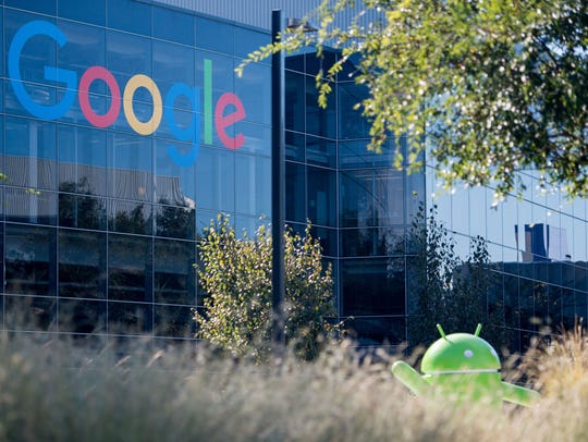 A Google logo and Android statue are seen at the Googleplex