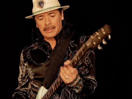 Guitar legend Carlos Santana and the band that bears