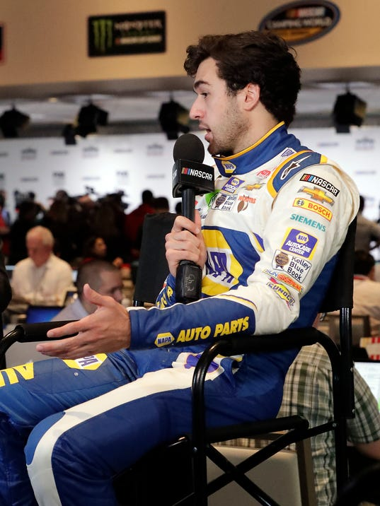 Chase Elliott takes part in an interview during media day for the NASCAR Daytona 500 auto race at Daytona International Speedway, Wednesday, Feb. 14, 2018, in Daytona Beach, Fla. (AP Photo/John Raoux)