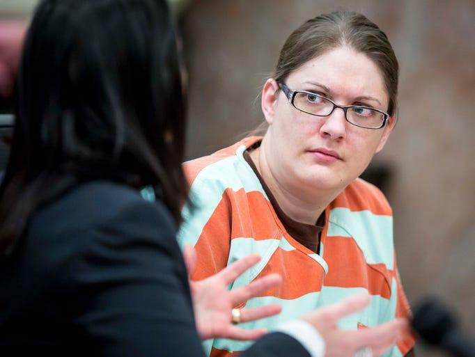 Nicole Finn talks to her public defender Jennifer Larson