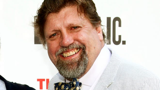 """FILE - In this June 6, 2016 file photo, Oskar Eustis attends the 2016 Public Theater Gala Benefit """"United States of Shakespeare"""" at the Delacorte Theater in New York. The theater director who endured death threats and lost corporate sponsors after staging a Donald Trump-inspired version of """"Julius Caesar"""" has a message to artists fearful of any backlash - don't flinch. """"We can't allow ourselves to feel overwhelmed. We can't allow ourselves to feel we're completely isolated. We're not,""""  Eustis, the artistic director of The Public Theatre, tells The Associated Press. (Photo by Andy Kropa/Invision/AP, File)"""