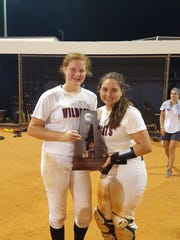 Estero freshman pitcher Alex Salter (left) and sophomore catcher Carly Campbell pose with the district championship trophy.