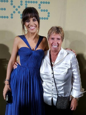 """Natalie Morales (left) and Rosie Casals appear together during the """"Battle of the Sexes"""" premiere at Westwood's Regency Village Theatre on Sept. 16."""