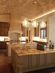 A very large kitchen with an arched brick ceiling and