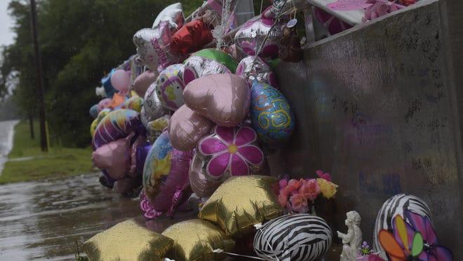 A memorial for Naomi Jones at the bridge over Eight Mile Creek is seen on Wednesday, June 7, 2017.