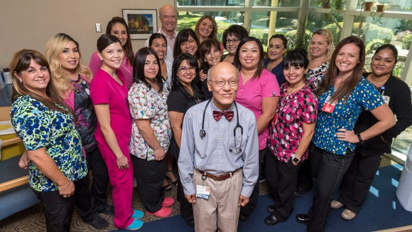 Dr. Shu-Dean Hsu, center, poses with staff on Thursday, August 17, 2017. Hsu retiring from Sequoia Regional Cancer Center after 40 years of practice.