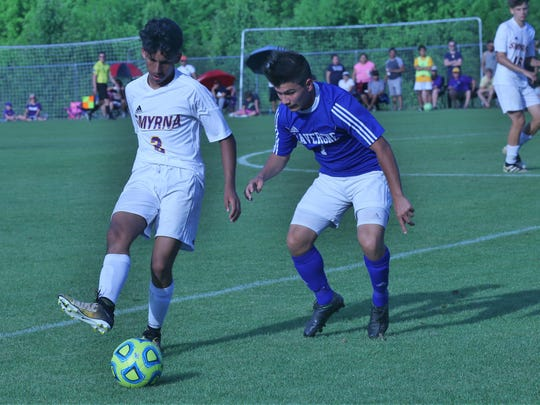 Smyrna's Kevin Avalos (2) and La Vergne's Alan Payan (7) battle for possession during Thursday's 9-AAA tourney finals.