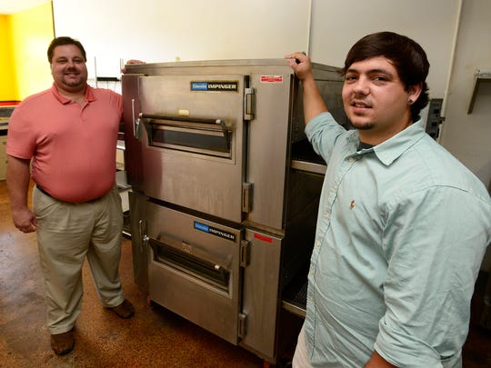 Store owner Scott Cardwell, left, store general manager Trevor Folcarelli at the new Folcarelli's Pizza they are opening on Atlanta Highway in Montgomery, Ala. on Thursday July 3, 2014.