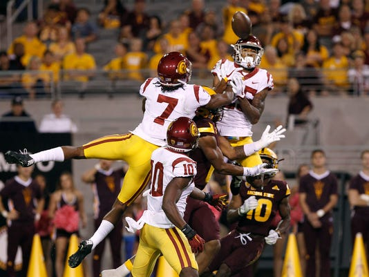 Southern California defensive backs Marvell Tell III (7), Jalen Greene (10) and Jack Jones try to knock down a pass in the end zone intended for Arizona State receiver Harry N'Keal, center, during the first half of an NCAA college football game, Saturday, Oct. 28, 2017, in Tempe, Ariz. Arizona State's Kyle Williams (10) came up with the catch for a touchdown to end the half. (AP Photo/Ralph Freso)
