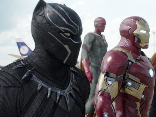 Black Panther (Chadwick Boseman, left) joined Vision (Paul Bettany), Iron Man (Robert Downey Jr.), Black Widow (Scarlett Johansson) and War Machine (Don Cheadle) to make up Team Iron Man in 'Captain America: Civil War.'