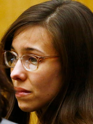 Jodi Arias reacts after she was found of guilty of first-degree murder in the gruesome killing of her one-time boyfriend, Travis Alexander, in their suburban Phoenix home  in Phoenix.