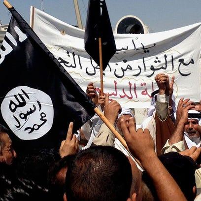 Demonstrators chant pro-al-Qaida-inspired Islamic State